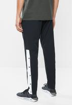Under Armour - Unstoppable 96 tearaway pant - black & white
