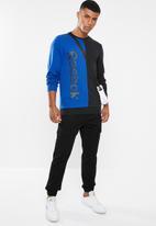 Reebok - Training essentials linear logo crew sweater - blue & black