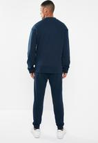 Reebok - Training essentials linear logo tracksuit - navy & white