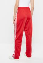 adidas Originals - Adi colour firebird trackpants - red