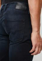 GUESS - Vega slim fit taper jeans - blue