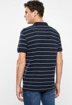 Tommy Hilfiger - Tjm essential fine stripe polo - navy & white