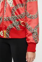 Nike - Nike sportswear syn fill glam jacket - red