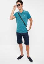 Lee  - Icon melange polo - turquoise