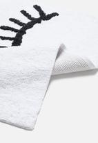 Sixth Floor - Winking tufted bath mat - white & black
