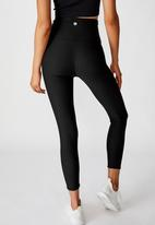 Cotton On - Reversible 7/8 tight scratchy animal - black
