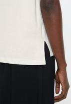 MANGO - Round neck tee - pale beige