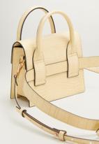 MANGO - Minipoo bag - beige