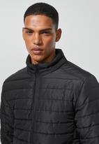 Superbalist - Lightweight puffer jacket - black