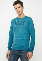 S.P.C.C. - Rockaway dirty dye crew neck logo sweat - blue