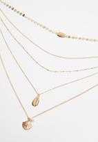 Superbalist - Multi-layered cowrie shell necklace - gold