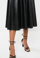 VELVET - Pleather circle midi skirt - black