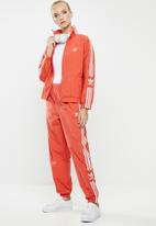 adidas Originals - Adicolour lock up track pants - orange & white