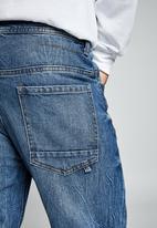 Cotton On - Tapered leg jean - aged indigo