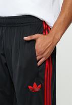 adidas Originals - SST50 track pants dmc - black & red