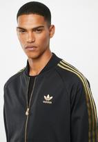 adidas Originals - Sst50 track top 24k - black & gold
