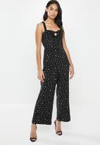 Glamorous - Petite messy spot spaghetti strap jumpsuit - black & white