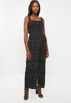 Glamorous - Maternity messy spot spaghetti strap jumpsuit - black & white