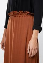 edit - Pull on knit midi skirt - rust