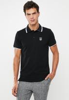 S.P.C.C. - Braddock pique golfer - black