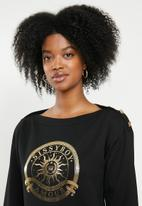 Sissy Boy - Logo crest sweater with button detail - black