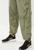 adidas Performance - Woven pants - green