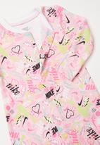 Nike - Scribble coverall and headband - pink