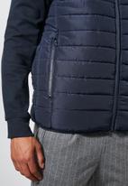 Superbalist - Lightweight sleeveless puffer jacket - navy