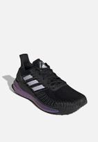 adidas - Solar boost 19 w - core black/purple tint/solar red