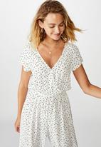 Cotton On - Woven Janine short sleeve jumpsuit daisy spots - white