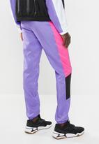 PUMA - Retro pants - purple & pink