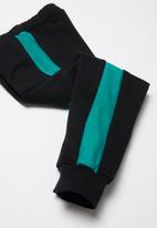 POP CANDY - Colour block trackpants - black & blue
