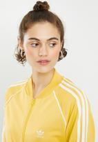 adidas Originals - Adicolour sst track top - yellow
