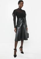 MILLA - Paneled pu circle skirt - black