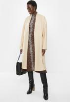 MILLA - Collarless coat - beige