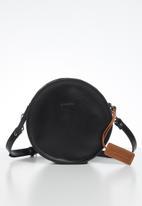 FSP Collection - Raw edge round veg leather bag - black