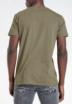 S.P.C.C. - Barrow straight hem logo tee - green