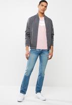 Levi's® - Housemark graphic tee - pink