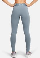 Under Armour - Favourite graphic legging - turquoise