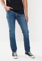 Levi's® - 510™ skinny goldenrod tint overt - blue