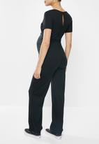 Missguided - Maternity wrap belted ribbed wide leg jumpsuit - black