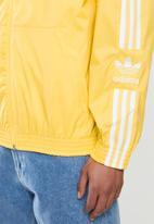 adidas Originals - Lock up tracktop - yellow