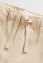 MANGO - Trousers horse - sand