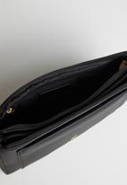 POLO - Lyon pebble sling - black