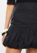 Blake - Fine twill mini skirt with bubble hem - black