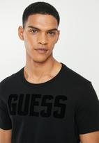GUESS - Basic short sleeve flock crew tee - black