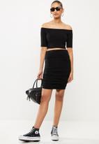 Blake - Mini ruched skirt - black