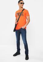 Diesel  - D-luster straight cut jeans - blue