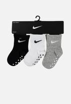 Nike - Core swoosh gripper - multi