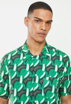 Mami Wata - Mami banana shirt - looser fit - green & brown